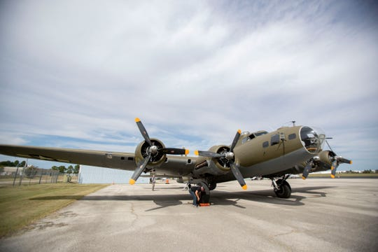 A B-17 Flying Fortress sits on the tarmac Monday, Oct. 14, 2019, at the Olive Branch airport in Miss.