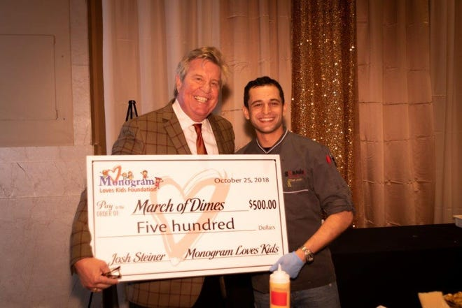 At Meat Me in Memphis, each chef picks which charity they would like to have receive their donation. Pictured are Karl Schledwitz (L), Chairman and CEO of Monogram Foods, and Chef Josh Steiner (R) of Strano by Chef Josh.