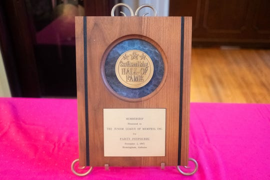 "An award from Southern Living is displayed inside the Junior League of Memphis' house, celebrating their cookbook, ""Party Potpourri."""