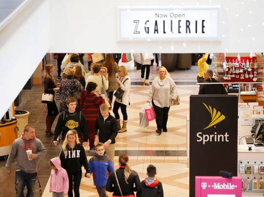 Mayfair Mall shoppers on the first floor search for bargains in 2016. A large brawl Oct. 12 prompted mall officials to reinstate a police requiring adult supervision of teenage and younger guests on weekends.