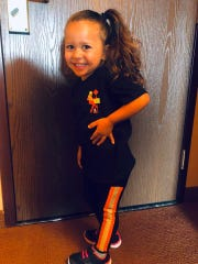 Melissa Gaglione's daughter, Jaylissa, wears a pair of leggings designed by her mom for her company, Safety4Her.