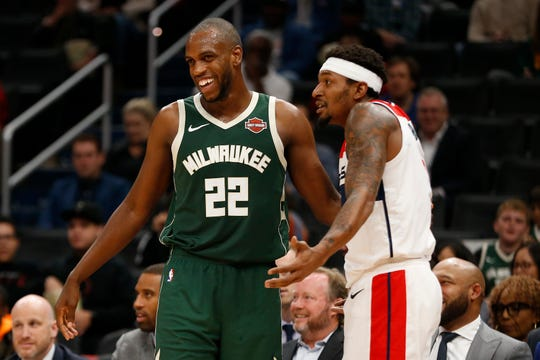 Wizards guard Bradley Beal (right) gestures after being called for a foul as Bucks forward Khris Middleton laughs in the third quarter at Capital One Arena. Middleton led the Bucks with 22 points.