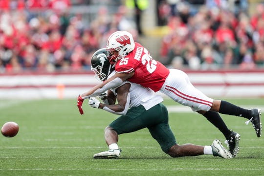 Wisconsin's Eric Burrell breaks up a pass intended for Michigan State's Darrell Stewart last week at Camp Randall Stadium.
