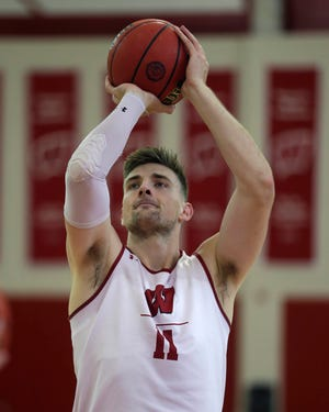 Wisconsin center Micah Potter shoots during practice at the Kohl Center on Oct. 11.