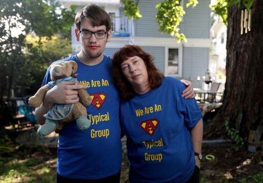 "Sandy Krause, right, with her child, Kelly, at their home in Wauwatosa. Kelly Krause is an autistic activist in metro Milwaukee, and both have been advocating to change what is considered ""normal"" and ""abnormal."""