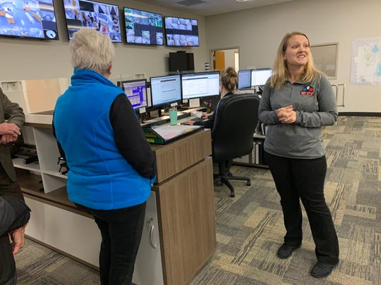 Angela Cvikel, a Muskego police dispatcher, explains the operational features inside the department's dispatch center during an Oct. 10 open house. The city showed off its new $10 million facility following a ribbon-cutting ceremony.
