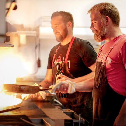 Chefs Dan Jacobs and Dan Van Rite are cooking over a live fire at Ash, the new restaurant inside the Iron Horse Hotel.