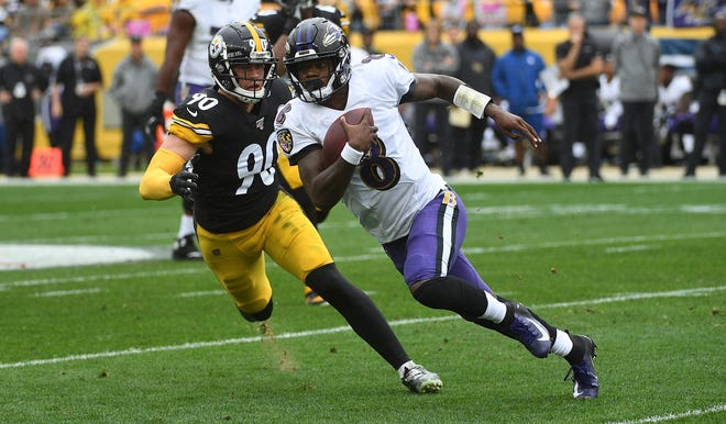 T.J. Watt of the Pittsburgh Steelers tries to chase down Lamar Jackson of the Baltimore Ravens during the first quarter Oct. 6, 2019, at Heinz Field in Pittsburgh. The two meet again Sunday in a showdown for first place in the AFC North.