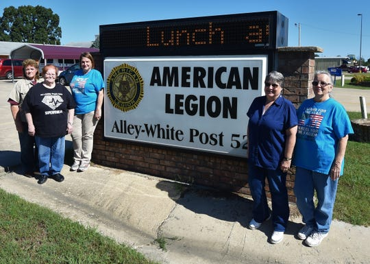 Alley-White American Legion Auxiliary Unit 52 members (from left) Freeda Evans, Shelia Smith-Pemberton, Nancy Stang, Karen Mikulewicz and Suzan Kaye stand next to the Legion's street sign at 717 Market Street. The Legion Auxiliary will hold an open house Saturday from 1 p.m. until 4 p.m.