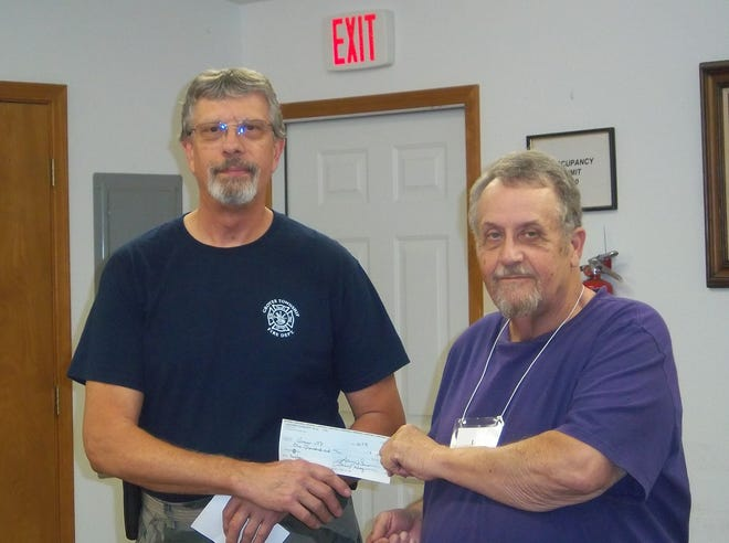 Larry Hazen (right), President of the Lakeview Community Club recently presented a check for $1,000to Chief Jim Sierzchula of the Grover Township Fire Department. Sierzchulashared with the members of the club that the Fire Department recently purchaseda new camera that will help to save lives. The thermographic camera — also called an infrared camera,thermal imaging camera or infrared thermography —is a device that forms a heat zone image using infrared radiation, similar to a common camera that forms an image using visible light. The donation will help to cover part of the cost.