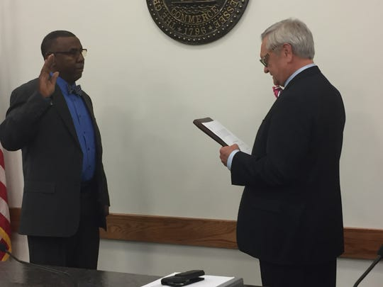City Attorney Jerry Smith (right) administers the oath of office to Councilman Dwight E. Haynes (left) at the Dickson City Council meeting Monday, Oct. 7, 2019. After winning re-election last month, Haynes begins his fourth elected term representing the Fourth Ward on the Dickson City Council. First elected in 2007, Haynes is the longest-tenured member of the council.