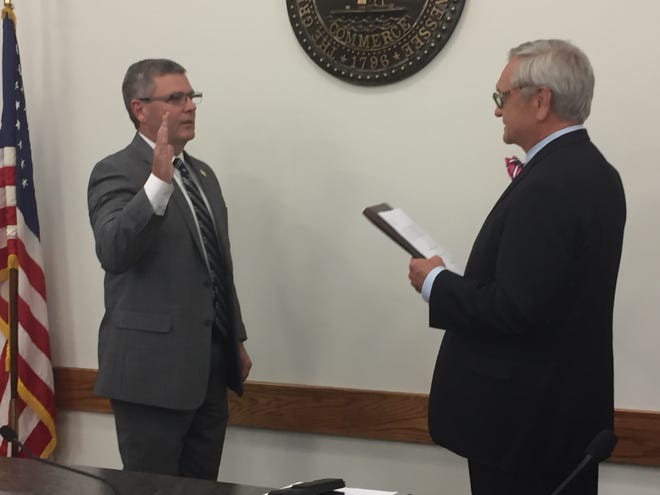 City Attorney Jerry Smith (right) administers the oath of office to Councilman Robby Harmon (left) at the Dickson City Council meeting Monday, Oct. 7, 2019. After winning re-election last month, Harmon begins his second elected term representing the Second Ward on the Dickson City Council. Mayor Don L. Weiss Jr. also nominated Harmon for re-appointment as vice mayor Monday night and he was confirmed by the council.