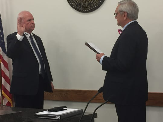 City Attorney Jerry Smith (right) administers the oath of office to Mayor Don L. Weiss Jr. (left) at the Dickson City Council meeting Monday, Oct. 7, 2019. After winning re-election last month, Weiss begins his seventh elected term as mayor. He was first appointed to complete the term of Tom Waychoff in December 1993 after serving six years on the council.