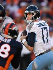 Titans quarterback Ryan Tannehill (17) drops back to make a throw during the third quarter of Sunday's game against the Broncos.