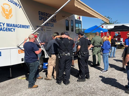 On Oct. 14, 2019, a group of emergency responders gather around a map of the area where 12-year-old Sean Cummings went missing in Gallatin.