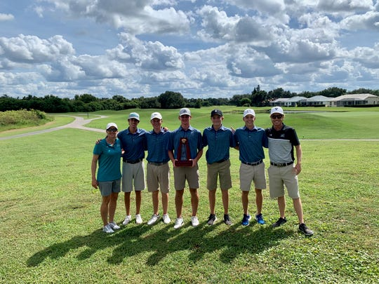 The Gulf Coast boys golf team poses for a picture following their fourth consecutive district title win.