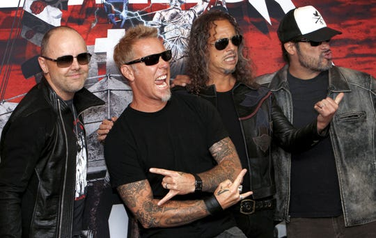 Metallica in 2012, from left: Lars Ulrich, James Hetfield, Kirk Hammett and Robert Trujillo.  Marco Ugarte/AP FILE- In this Saturday, July 28, 2012, file photo, members of the band Metallica, from left to right, Lars Ulrich, James Hetfield, Kirk Hammett and Robert Trujillo, pose at a photo-call before their first of eight concert performances in Mexico City.  Metallica said Wednesday, Aug. 14, 2019, it has donated 250,000 euros (dollars 277,600) to support the construction of Romania's first paediatric oncology hospital.(AP Photo/Marco Ugarte, FILE)