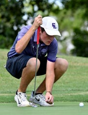 Cypress Lake High School Tyler Humphrey lines up the ball with the hole during the Class 2A-District 12 boys golf tournament at Lely Resort's Flamingo Island Course in Naples,Monday, Oct. 14, 2019.