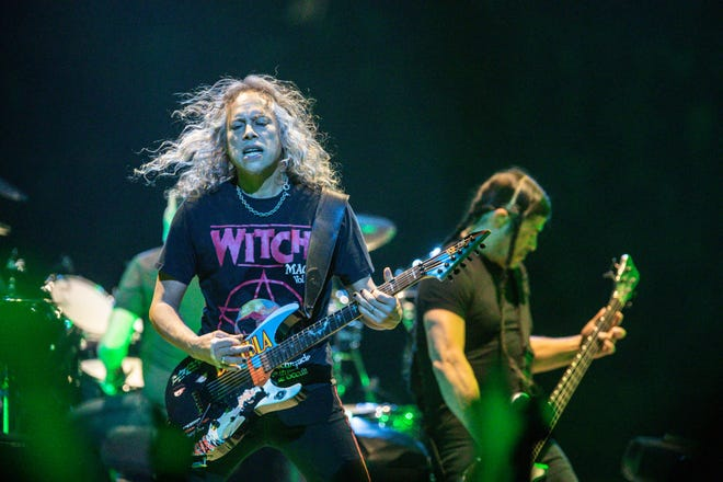 Metallica members Kirk Hammett, left, and Robert Trujillo perform as the band brings their WorldWired Tour to Bankers Life Fieldhouse in Indianapolis in March 2019.