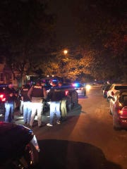 Police make a patrol stop at East 28th Street and 15th Avenue in Paterson on Saturday night.