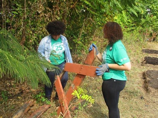 Teen volunteers during Paterson nonprofit group's recent cleanup event celebrating the organization's 25th anniversary.
