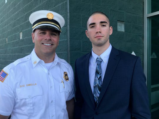 Passaic Deputy Fire Chief Christopher Dibella with his son, a fire fighting recruit, also named Christopher after Monday's recruiting introduction ceremony at Passaic County Fire Academy. The son is training to become a member of the Paterson Fire Department.