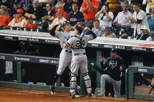 New York Yankees' Aaron Judge, left, celebrates his two-run home run with Gary Sanchez during the fourth inning in Game 2 of baseball's American League Championship Series against the Houston Astros Sunday, Oct. 13, 2019, in Houston.(AP Photo/Sue Ogrocki)