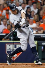 New York Yankees' Aaron Judge hits a two-run home run against the Houston Astros during the fourth inning in Game 2 of baseball's American League Championship Series Sunday, Oct. 13, 2019, in Houston. (AP Photo/Matt Slocum)
