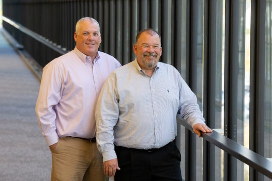 Vincent J. Hager, president, and Kenneth L. Hager, principal and C.O.O., pose together at JGS Insurance,  located inside Bell Works, in Holmdel, NJ Monday, October 14, 2019.
