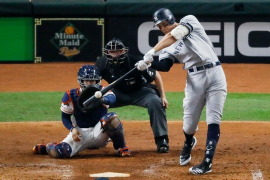 New York Yankees' Aaron Judge hits a two-run home run against the Houston Astros during the fourth inning in Game 2 of baseball's American League Championship Series Sunday, Oct. 13, 2019, in Houston. (AP Photo/Sue Ogrocki)