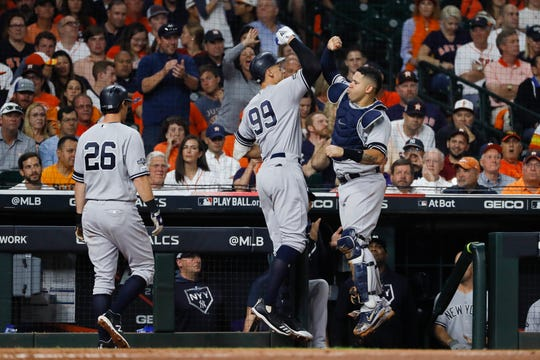 New York Yankees' Aaron Judge (99) celebrates his two-run home run with Gary Sanchez, right, during the fourth inning in Game 2 of baseball's American League Championship Series against the Houston Astros Sunday, Oct. 13, 2019, in Houston. (AP Photo/Matt Slocum)