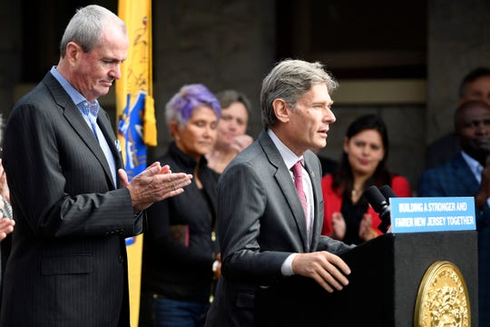 "Gov. Phil Murphy, left, and U.S. Rep. Tom Malinowski announce that the Raritan Valley Line's partial ""one-seat ride"" to New York during off-peak hours is being restored in a press conference at the Westfield NJ Transit station on Monday, Oct. 14, 2019."