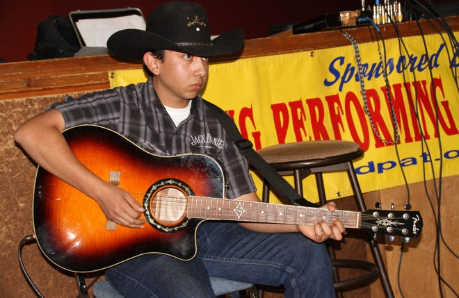Hatch Valley pecan farmer Eric John Silva, 18, was a special guest on Sunday at the Deming Performing Arts Theater Jam Session. Silva sat in with the local musicians and turned out some classic country-western ballads.