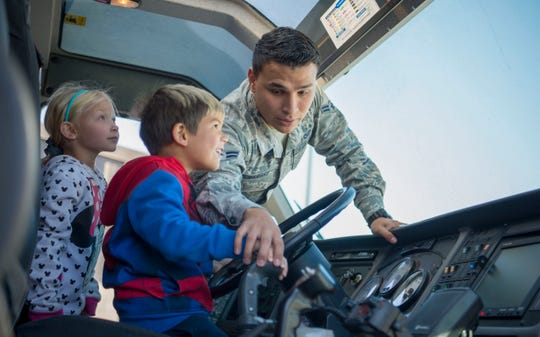 Airman 1st Class Joseph Vargas, 49th Civil Engineer Squadron firefighter, shows students the driver's seat of a firetruck, Oct. 11, 2019 on Holloman Air Force Base, N.M. The 49th Civil Engineer Squadron firefighters spread fire safety awareness every year on the week of October 9th for National Fire Prevention Week.