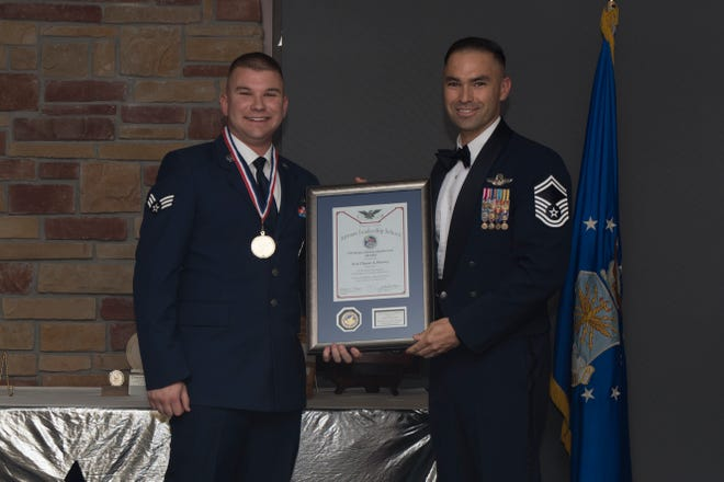 Senior Airman Chase Feeney, Airman Leadership School graduate, accepts the distinguished graduate award during the graduation of ALS class 19-7, October 10, 2019, on Holloman Air Force Base, N.M. The distinguished graduate award is presented to the top ten-percent of graduates for their performance in academic evaluations and demonstration of leadership.