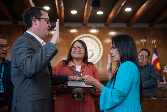 Carl Roessel Slater, left, takes the oath of office for the Navajo Nation Council on Oct. 10 in Window Rock, Arizona.