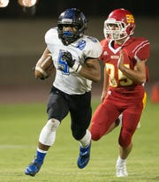 Orlando Wallace runs for a touchdown during a DVL football game held at Palm Desert High School Friday evening, October 17, 2014.