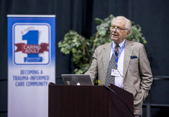 Dr. Vincent Felitti, investigator for the Adverse Childhood Experiences study, speaks Monday during the Lakeview Center/Baptist Health Care's Trauma-Informed Care Partners Conference at the Pensacola Bay Center.