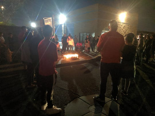At least twenty people gathered on Oct. 13, 2019, for a candlelight vigil honoring a 17-year-old boy who was shot and killed by a Glendale police officer while leaving a party early that morning.