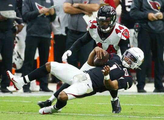Atlanta Falcons defensive end Vic Beasley (44) horse-collar tackles Arizona Cardinals quarterback Kyler Murray (1) in the second half during a game on Oct. 13, 2019 in Glendale, Ariz.