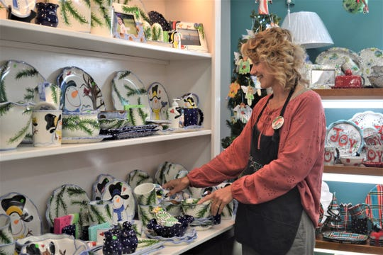Packer Creek sales associate Beth Thorbahn works amongst some of the shop's winter pieces. Packer Creek Pottery will celebrate four decades in business at a birthday bash on Saturday.