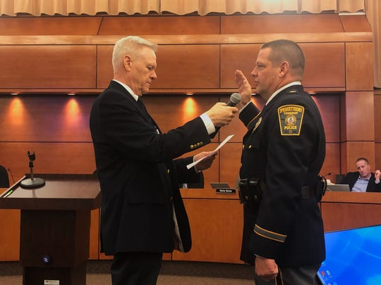 Chief Todd King, right, of the Springettsbury Township Police Department took his oath of office Thursday, Oct. 10, during a meeting of the township Board of Supervisors. Chairman Mark Swomley performed the swearing-in ceremony.