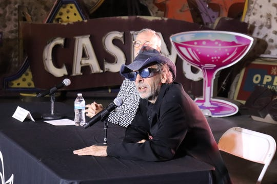 "Tim Burton answers questions at a news conference in Las Vegas kicking off the opening of his new art exhibition at the Neon Museum, ""Lost Vegas."""