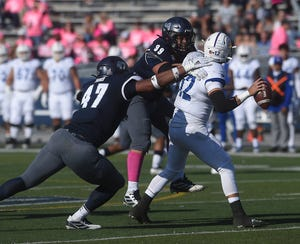 Defensive linemen Kameron Toomer (47) and Dom Peterson will look to put big pressure on Cal quarterback Chase Garbers and the rest of the Bears' offense Saturday night.