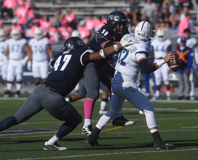 Nevada's Dom Peterson (99), shown sacking San Jose State's Josh Love along with teammate Kameron Toomer, was named as a first-team selection on the postseason All-Mountain West list.