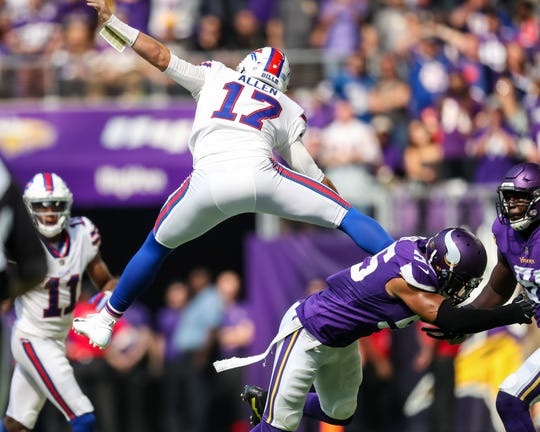 Josh Allen hurdles Minnesota Vikings linebacker Anthony Barr during the Bills shocking 27-6 victory over the Vikings last season.
