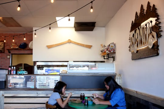 Sisters Hanna, 10, and Noelle Ho, 12, eat lunch at their family's restaurant, Manna Japanese Comfort Food in Salem on Oct. 11, 2019. Manna has made the switch from a food truck to a brick and mortar restaurant.