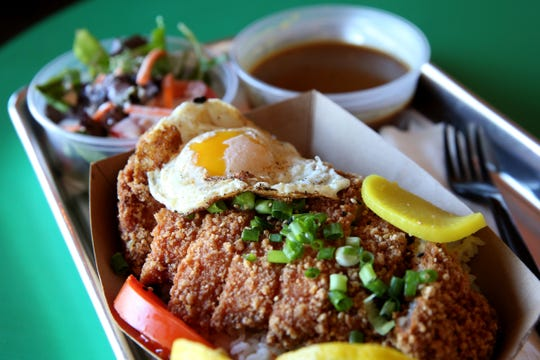 The tonkatsu, a breaded and fried pork cutlet, with curry rice and a house salad at Manna Japanese Comfort Food in Salem on Oct. 11, 2019. Manna has made the switch from a food truck to a brick and mortar restaurant.