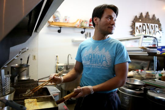 Francis Ho makes tamago, a Japanese-style folded omelette, at Manna Japanese Comfort Food in Salem on Oct. 11, 2019. Manna has made the switch from a food truck to a brick and mortar restaurant.