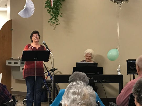 Evelyn Howell, 100, played the piano at the morning services at the Sagecrest Alzheimer's Care Center, 438 E. Houston Harte Expressway, on Monday, Oct. 14, 2019.